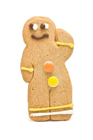 Gingerbread Man from low perspective isolated against white background. photo
