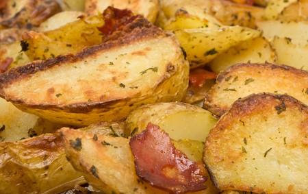 Spicy Potato Wedges with Chorizo Sausage on baking tray straight from oven.