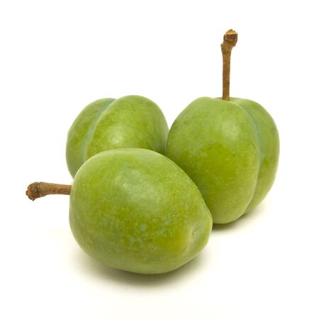 low perspective: Green Plum from low perspective isolated against white. Stock Photo