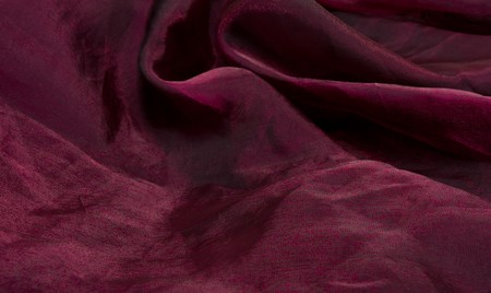 Luxury Purple Satin Background with curvy folds. photo