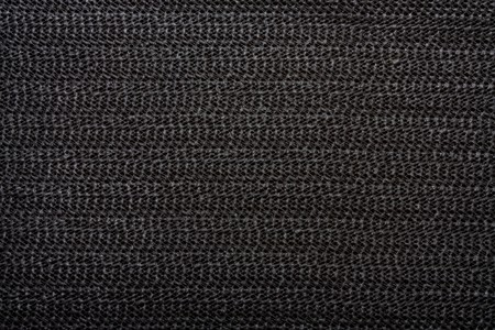Black non slip Silicon or rubber mat background or texture. photo