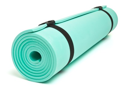Lightweight foam Camping Bed roll isolated on white.