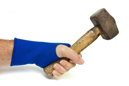 Male hand wearing blue neoprene wrist support using heavy hammer over white. Stock Photo - 7740590
