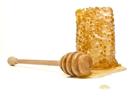 honey comb: Natural Honeycomb from low perspective isolated on white. Stock Photo