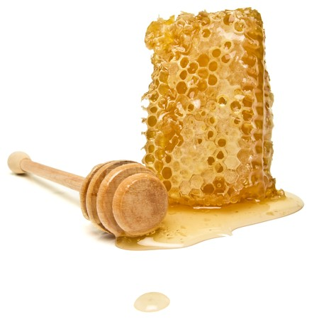 Natural Honeycomb from low perspective isolated on white. Standard-Bild