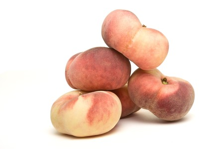 Exotic Flat peach also known as donut, chinese or saturn peach. photo