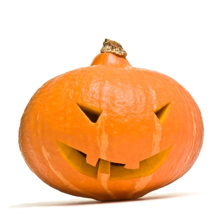 Evil looking Halloween Pumpkin Head from low perspective isolated on white. photo