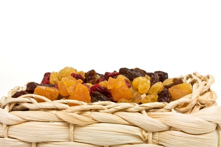 Mixed Dried Fruits of Apricots, sultana, raisins and cranberries in wicker basket. photo