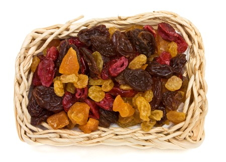 Mixed Dried Fruits of Apricots, sultana, raisins and cranberries in wicker basket. Stock Photo - 7846684