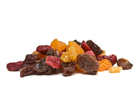 Heap of Mixed Dried Fruits of Apricots, sultana, raisins and cranberries. photo
