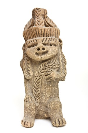 Eerie and ugly Mayan Statue isolated on white background. photo