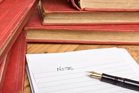 Pile of old books, note paper and fountain pen to depict research concept. Stock Photo - 7846688