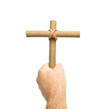 anti smoking: Anti Smoking concept of male hand holding crucifix made from 2 cigars tied with rope isolated on white.