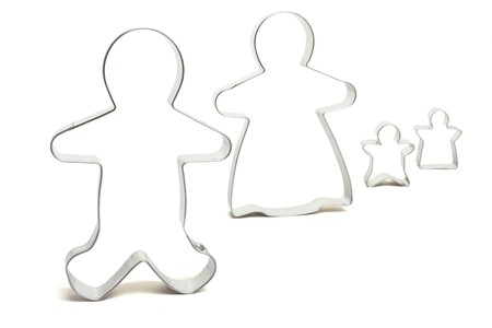 ktchen: Family Unit Abstract concept of set of cookie cutters isolated on white.