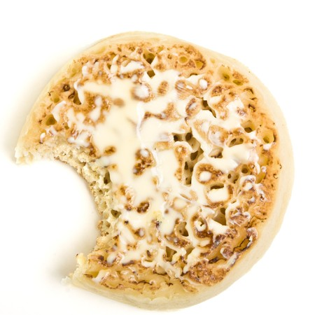 buttered: Traditional English Hot Buttered Crumpet with melting butter.