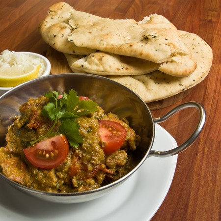 Indian Curry meal of spicy chicken, rice and naan bread. Stock Photo