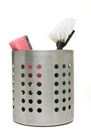 Scouring sponge and brush used for washing dishes in steel container. Stock Photo - 7909977