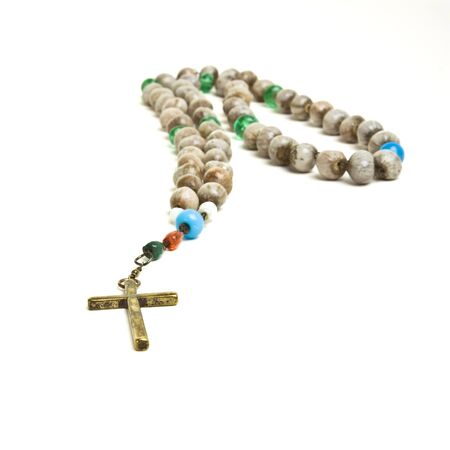 Rosary beads of decorated hazlenuts from low perspective isolated against white. Stock Photo - 7987887