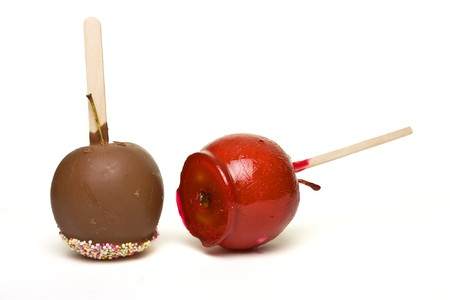 Toffe and chocolate coated apples from low perspective isolated on white.