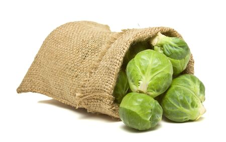 brussel: Sack of Brussel Sprouts from low perspective isolated on white.