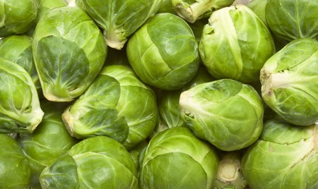 background or texture of fresh green Brussel Sprouts. Stock Photo