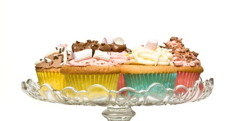 A selection of fancy homemade cupcake on glass pedestal cake stand. Stock Photo - 8064853