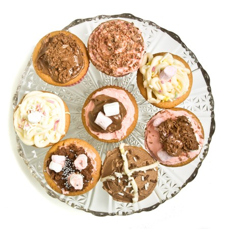 A selection of fancy homemade cupcake on glass pedestal cake stand. Stock Photo - 8064863