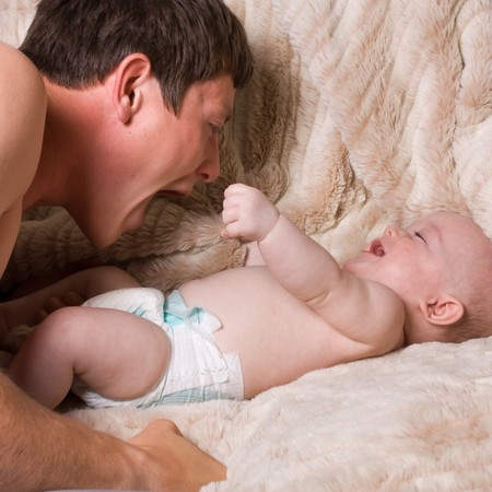 Young first time father playing with baby son. Stock Photo
