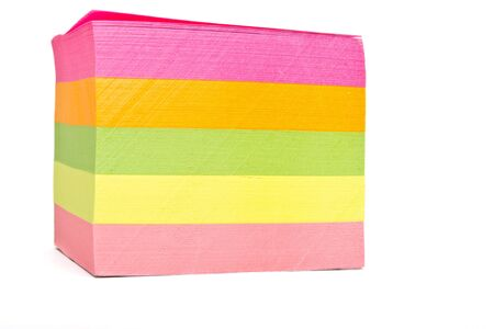 Vibrant block of multicolored post it notes isolated on white. photo