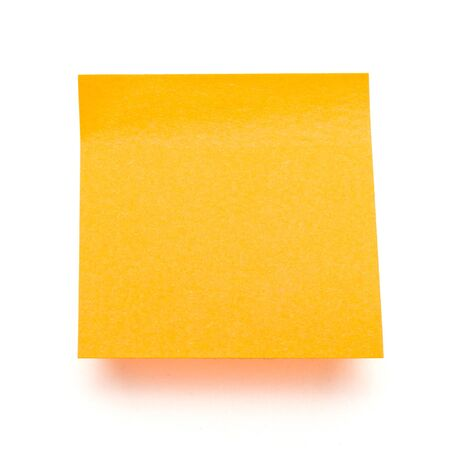 orange self adhesive post it note isolated on white. photo