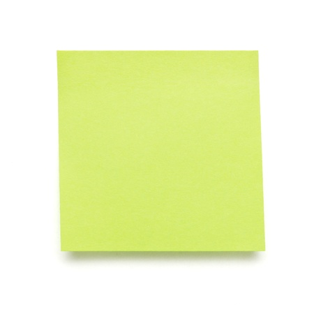 green self adhesive post it note isolated on white.