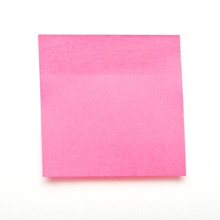 dark Pink self adhesive post it note isolated on white. photo