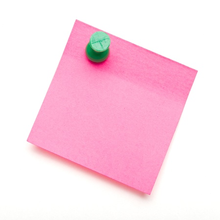 Dark pink self adhesive post it note with green push pin on white. Stock Photo