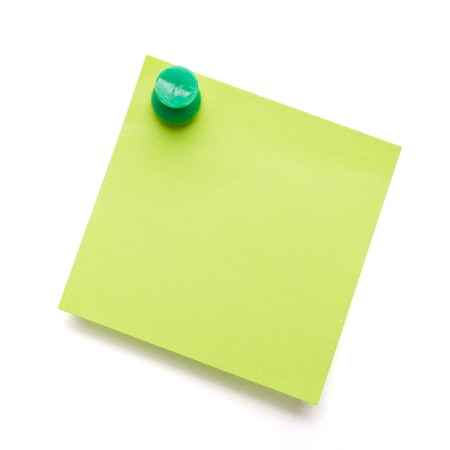 Green self adhesive post it note with green push pin on white.
