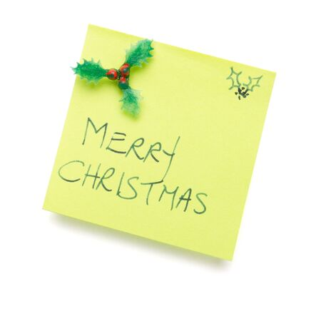 merry christmas message on post it note isolated on white. photo