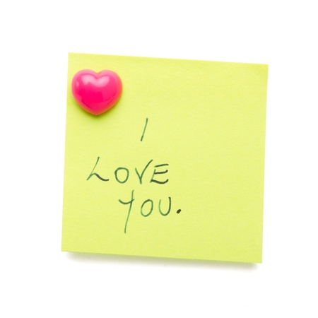 written communication: I love you message on post it note isolated on white.