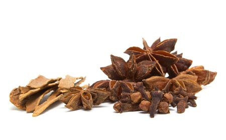 low perspective: Winter spices of Cinnamon, cloves and Star Anise from low perspective isolated on white.