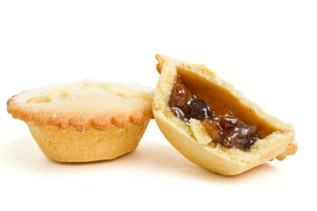 Festive sweet mince pies from low perspective isolated on white.