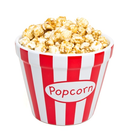 red and white bowl of popcorn from low perspective isolated on white.