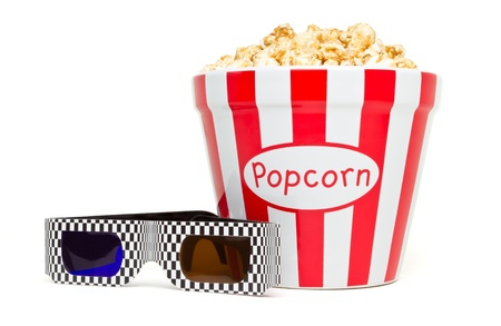 red and white bowl of popcorn with 3D glasses from low perspective isolated on white. photo