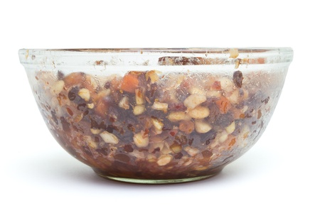Glass bowl Xmas Cake Mix of nuts and soft fruits soaking up added rum, brandy and sherry. photo