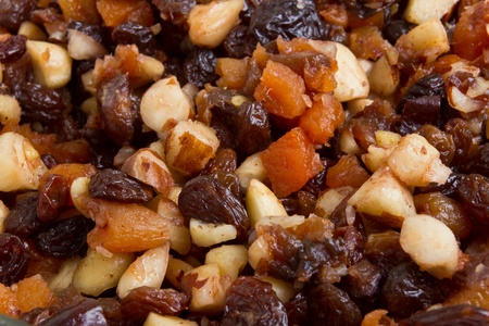 Background or texture of Xmas Cake Mix of nuts and soft fruits close up. photo