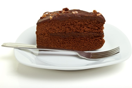 chocolate mousse: Slice of homemade Chocolate Cake isolated on white.