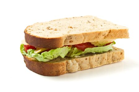Vegetarian Sandwich of cheese, tomato and lettuce on brown Granary bread. photo