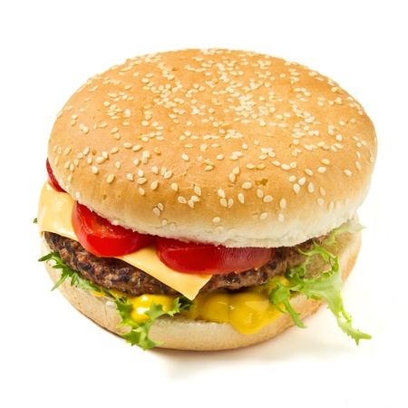 Cheeseburger and Mustard in sesame seeded bun isolated on white. photo