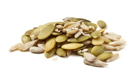 pumpkin seed: Three seed mixture of  Pumpkin, sunflower and sesame seeds isolated on white. Stock Photo