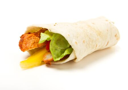 Spicy chicken with salad and salsa wrapped in a soft flour tortilla. photo
