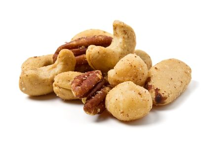 Mixed Salted Nuts from low perspective isolated on white. photo