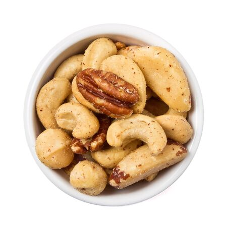 Mixed Salted Nuts in bowl overhead view isolated on white. photo