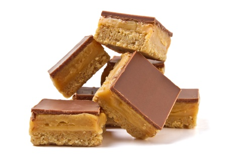 caramel: Luxury Shortbread called millionaires shortbread isolated on white. Stock Photo
